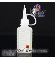 Liquide de coupe : 50 ml huile minérale blanche